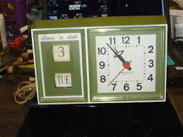 1960s vintage retro westclox electric time n date clock wall table green