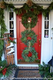 wreaths for front doorsFront Porch Decorated for Christmas with Three Wreaths on Door and