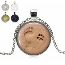 footprint and paw in the sand gl dome necklace