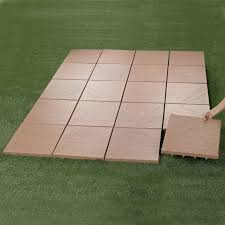 create an instant patio on any grass dirt or sand surface ultra lightweight tiles have spiked bottoms that dig into ground for ility