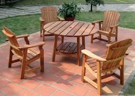 round picnic table with four deck chairs wooden patio furniture ideas