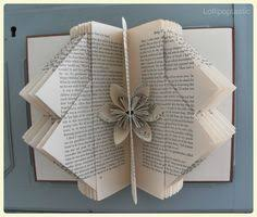 hand folded book art featuring a beautiful origami flower