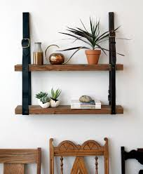 a hanging leather shelving