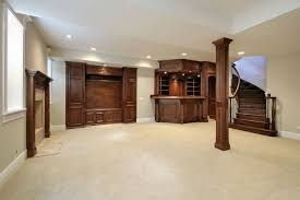 game room lighting ideas basement finishing ideas. Stunning Basement Finishing Idea With Beige Wall Paint Color And White Ceiling Carpet Also Wood Cabinets Pillar Fireplace Mantel Game Room Lighting Ideas