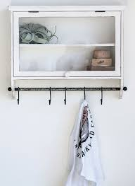 wall cabinet with shelf and hooks