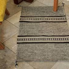 brown and beige hand loomed wool area rug 2x3 land of my people