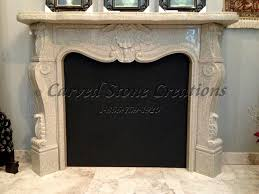 carved polished granite french country fireplace mantel