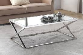 rectangle glass top coffee table with stainless steel frames and pedestal on white fur rug