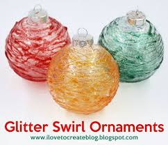 the holidays are upon us and what is more fun than getting cozy and crafting up a storm these glitter swirl ornaments are the perfect way to add a little