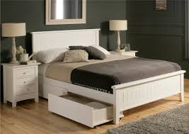 Furniture. white wooden storage bed with headbard and black grey blanket  combined by white table