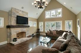 A new construction home with a beautiful light stone wood burning fireplace  and a large U