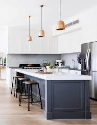 modern white kitchen island. An Elegant Modern White Kitchen With A Grey Island Thick Countertop
