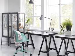ikea office furniture canada. a home office with tornliden desk in black fabrikr glass cabinet and roberget swivel ikea furniture canada