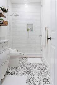 black and white tile bathroom with a dresser turned into a vanity and a tall infinity