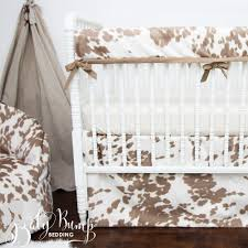 tan cowhide gender neutral baby crib bedding