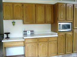 painting vs staining kitchen cabinets full image for can you stain over painted kitchen cabinets old