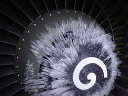 ice aculation on the spinner of a jet engine