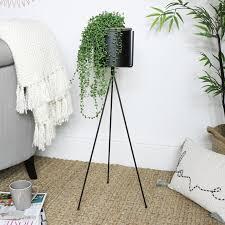 tall black metal plant stand