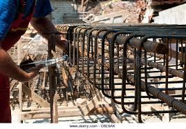 construction worker ties reinforcing steel rebar close up stock image rebar worker