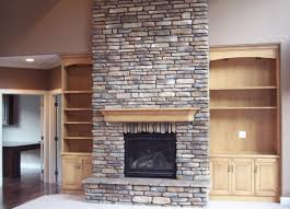 stone fireplace built in bookshelves | Massive stone fireplace