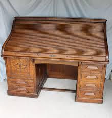 antique quarter sawn oak heavy paneled roll top desk 66 inches length