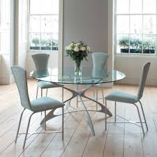 glass dining room set. Wooden Laminate Floor With Elegant Round Glass Dining Table Set Room