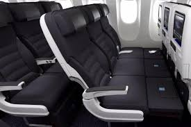 air new zealand s skycouch allows for a row of three economy seats to be converted into a flat bed air new zealand
