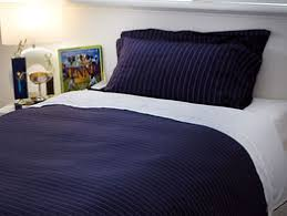 Designer Teens Bedding - EcoSleep Australia & Navy blue with a small white dotted line. Each sets has 1 quilt cover and  matching pillow case(s) and 1 white cotton clip on top sheet. Adamdwight.com