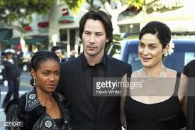 "Photo of Jada Smith & her friend actress  Carrie-Anne Moss - Movie ""The Matrix"""