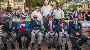 disneyland honors tuskegee airmen during flag ceremony six men most of them in their nineties proudly stood at attention as the disneyland band played wild blue yonder the official song of the u s air