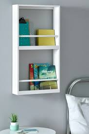 white wall mounted bookcase from