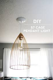 make some diy lighting using an inexpensive cage this custom pendant light fixture is great