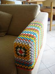 granny square chair arm cover no pattern but an explanation of making a granny square and then only crocheting on 3 sides to shape it