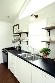 paint your kitchen countertops fake it til you make it 5 kitchen disguises i just painted my old yucky wood s black thanks to at can you paint kitchen