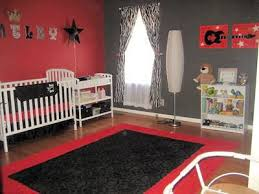 Baby boy rock star nursery theme in red, black and white with Fender guitar  and