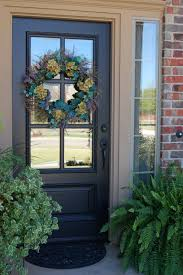wreath hang on 6 mirrored panels front door ideas with grey painted and brushed bronze handle also brick exterior