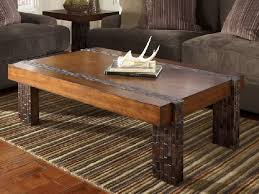 modern rustic coffee table square shape with deer horn on the top of table image
