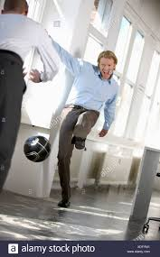 Men Are Playing Soccer In An Office Stock Photo 283707425 Alamy