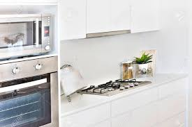 Modern Kitchen Tools With White Walls And Oven Gas Cooker Also