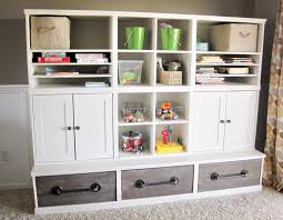 amazing diy playroom storage plans by ana-white.com love the pipe handles  and