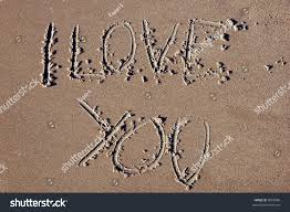 stock photo love letters in the sand