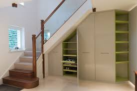 Interior Gray Wooden Storage With Green Shelves Under The White Stairs  Brown Handlers Stair Shelves