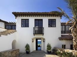 white stucco house exterior mediterranean with spanish freestanding  birdhouses