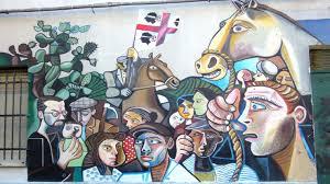 Risultati immagini per sardegna murales foto