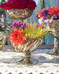 bowlsful of blossoms are the way to dress an extravagant table combine jewel tone flowers