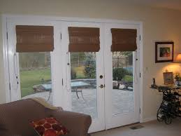 brown roman shade on white wooden three glass panel french door as well as blinds for french doors with windows also wooden blinds for french doors