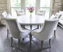 bright and light breakfast nook with round table and six seats
