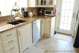 there wasn t a backsplash in the kitchen and we really loved the look of one so purchased tumbled marble tiles from the home depot that scott installed