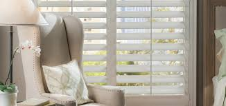 For a more traditional feel consider these Faux Wood French Door Shutters  as your glass door
