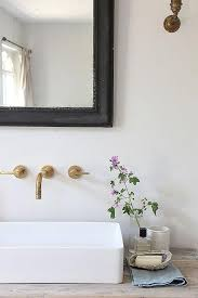 wall mount vessel sink faucets. Cottage Bathroom Features Reclaimed Wood Vanity Topped With Rectangular Vessel Sink Under An Aged Brass Faucet And Black Beveled Mirror In Wall Mount Faucets